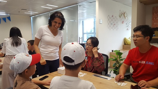 Galit Zamler leads a workshop for a group of parents and children from China
