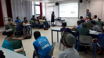 Galit Zamler leads a Hackathon for teenagers at school