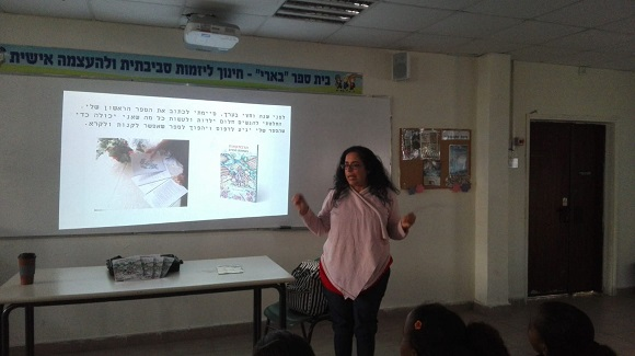 Maayan Kapach in a lecture on the book Adventures in the Cabbage Grove