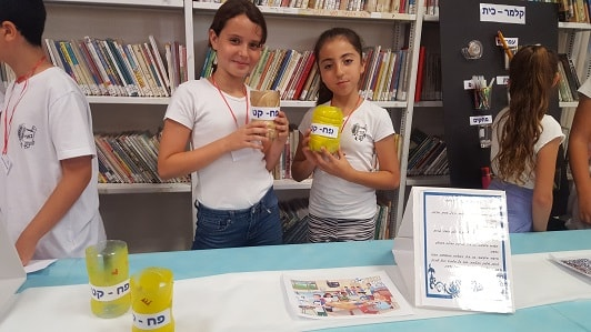 A small tin for each student attached to the table, an invention of Israeli girls
